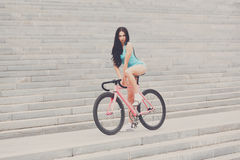 Young slim sexy sportive woman on bicycle Stock Photography
