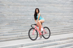 Young slim sexy sporty woman on bicycle Royalty Free Stock Images