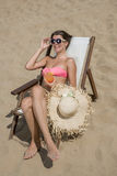 Young, slim and woman on the beach Stock Images