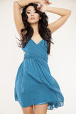 Young slim woman in blue dress on white background Royalty Free Stock Photos