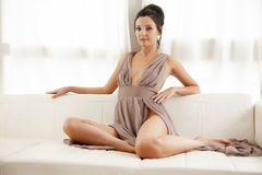 Young slim sexy woman in brown dress isolaten on white backgroun Royalty Free Stock Photos
