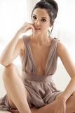 Young slim sexy woman in brown dress isolaten on white backgroun Stock Photo