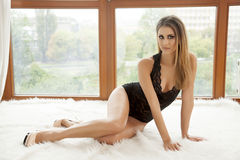 Young slim sexy woman in lingerie against the window Royalty Free Stock Photo