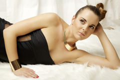 Young slim sexy woman in lingerie on the white fur Royalty Free Stock Images