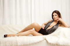 Young slim sexy woman in lingerie on the white fur Royalty Free Stock Photography