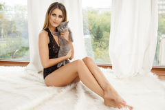 Young slim sexy woman in lingerie on the white fur Royalty Free Stock Photos