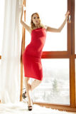 Young slim woman in red dress Stock Photos