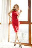 Young slim woman in red dress Stock Images