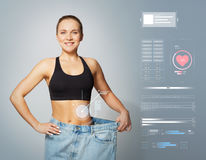 Young slim sporty woman in large size pants Stock Images