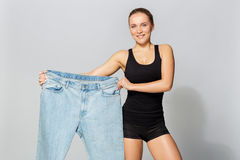 Young slim sporty woman with oversize pants Royalty Free Stock Photo