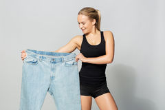 Young slim sporty woman with oversize pants Royalty Free Stock Images