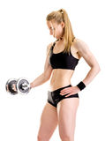 Young slim strong muscular woman posing in studio Royalty Free Stock Photos