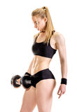 Young slim strong muscular woman posing in studio Royalty Free Stock Image