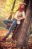 Young slim woman autumn portrait Stock Photos