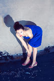 Young slim woman in blue dress