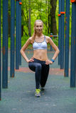 Young slim woman doing workout in a training ground Royalty Free Stock Photo