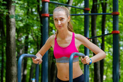 Young slim woman doing workout in a training ground Stock Images