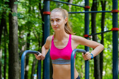 Young slim woman doing workout in a training ground Royalty Free Stock Photography