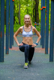 Young slim woman doing workout in a training ground Stock Photo