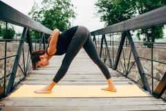 Young slim woman doing yoga Stock Photos