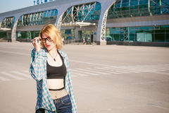 Young slim woman dressed in blue checked shirt, cap and jeans, Will depart at dawn on summer day on freedom trip with black travel royalty free stock photos