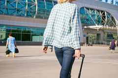 Young slim woman dressed in blue checked shirt, cap and jeans, Will depart at dawn on summer day on freedom trip with black travel stock photos
