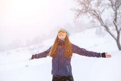 Young slim woman enjoying snowy weather in winter Royalty Free Stock Photography