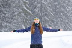 Young slim woman enjoying snowy weather in winter Royalty Free Stock Photos