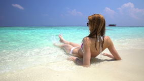 Young slim woman enjoying the turquoise waves of tropical beach. stock footage