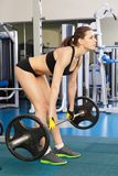 Young slim woman exercising in a gym Stock Photo