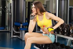 Young slim woman exercising in a gym.  Royalty Free Stock Photo