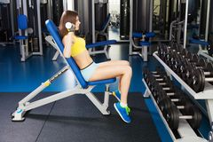 Young slim woman exercising in a gym Royalty Free Stock Images