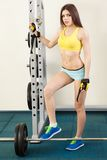 Young slim woman exercising in a gym Royalty Free Stock Image