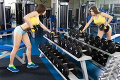 Young slim woman exercising in a gym Royalty Free Stock Photo