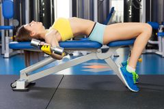 Young slim woman exercising in a gym.  Royalty Free Stock Images