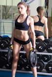 Young slim woman exercising in a gym Stock Images