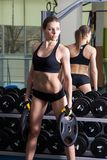 Young slim woman exercising in a gym.  Royalty Free Stock Photos