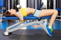 Young slim woman exercising in a gym Stock Photos