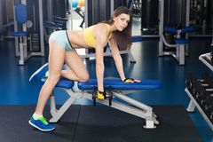 Young slim woman exercising in a gym Stock Image