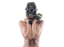 Young slim woman in gas mask covered breast royalty free stock photo