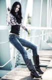 Young slim woman with guns royalty free stock images