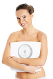 Young slim woman holding scope. Royalty Free Stock Photos