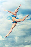 Young slim woman jumping Stock Image
