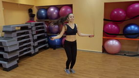 Young slim woman jumping with skipping rope in gym. stock video footage