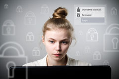 Young slim woman with laptop. Forgot password concept. Stock Image
