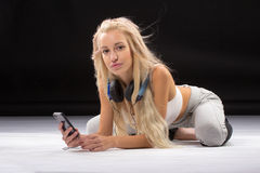 Young slim woman lying on the floor. Stock Photo