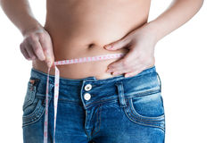Young slim woman with measurement type. Stock Images