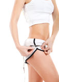 Young slim woman measuring her hips Stock Photography