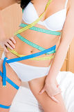 Young slim woman with measuring tapes Stock Photo
