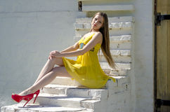 Young slim woman on old stone stairs Stock Images